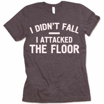 The listing is for one short-sleeve UNISEX crewneck t-shirt with 'I Didn't Fall I Attacked The Floo